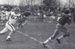 Ernie Edwards 22 (class of '65) runs past Clark defender in '63 Thanksgiving Game
